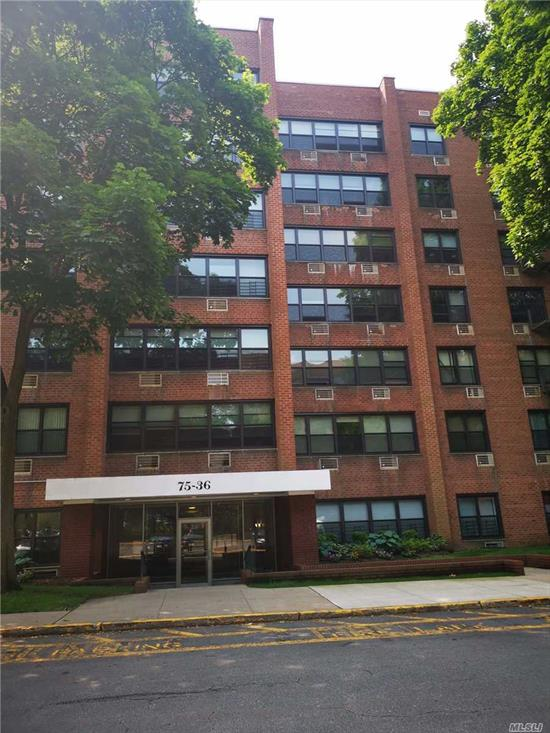 Spacious Rare find 2 bedrooms, 2 bathrooms Co-op at Windsor Park. Olympic size swimming pool, tennis court, Great school district 26 & Blue Ribbon elementary school P.S 205! Living room window facing the Cunningham Park!