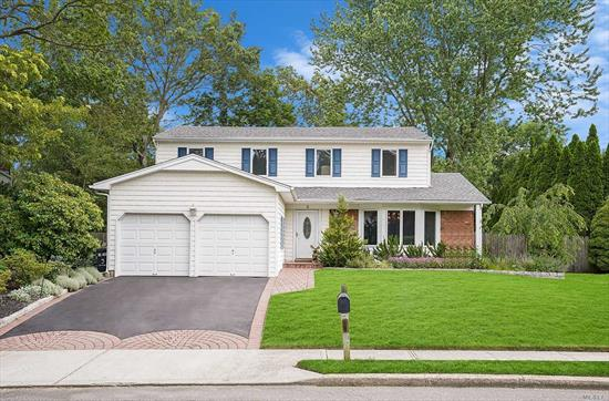Magnificent Colonial in Lake Grove w/sidewalks beautiful black top driveway w/paver border skirt & path. Updated White cedar impression front siding, 6 year young Roof. Open flr plan Hrdwd Flrs custom molding updated kit w/granite counter tops white appliances tile back splash recessed lighting lots of cabinet & counter space enormous den w/brick fpl updated .5 bth large Mst Bdrm w/full bth spacious backyard w/patio 2 car att garage 200 amp panel 6 year young boiler 7 year Cac