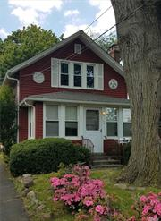 Charming Colonial With Original Woodwork And Low Property Taxes. Excellent For A First Time Home Buyer. Master Bedroom And Master Bath Are Located On The First Floor, Large EIK/DA, Fireplace In Living Room, Sunroom, Fenced Yard And Detached Garage. Lovely Residential Neighborhood Conveniently Located Near All. Call To Schedule A Showing Today!