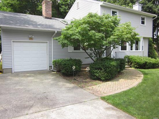 This sunny,  spacious and immaculate 3 Bedroom Colonial is set on a quiet spot back off the road on flat half acre in Harborfields Schools. Large bright LR w/FP, FDR, FR w/FP and skylights. Large EIK with sliders to deck with custom pergola, 2 updated full baths, CAC, gas heat, storage shed and lots of parking!