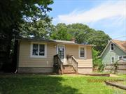 Small 3 bedroom 1 bath ranch style home with an unusual layout kitchen is on the lower level. Loads of potential for a homeowner with vision. Cash or 203K financing only.