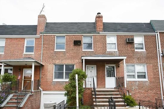 Location! Location! Location! Brick Single Family Brick Attached Townhouse, 3 Bedrooms + 1.5 Bath With Attached Garage. Zoning R4-1, Minutes To Q20A, Q20B, Q44, Q88. And Easily Access To LIE or GCP. Stores, Supermarket, Queens College & Ps 499 And Bakeries. Semi-Finish Walk-In Basement With Separate Entrance. Handyman Special Need Updating Touch up by the New Owner.