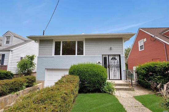 Recently updated Hi-ranch house with beautiful wood floors, extra large kitchen with New Cabinets. New Appliances, Updated bathrooms, new doors, new siding, gutters and leaders replaced. New Hot Water Tank, New Electric Box. Uniondale Schools.