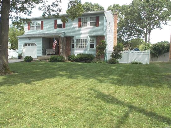 Quiet neighborhood. Plenty of recreational activities, spacious home ideal for entertaining.w/ Fireplace. Four large bedrooms, Eastport South Manor school district, fully fenced yard, room for boat or RV. Three heating zones. New Roof,  Short drive to the beach, close to LIE and Sunrise Highway.