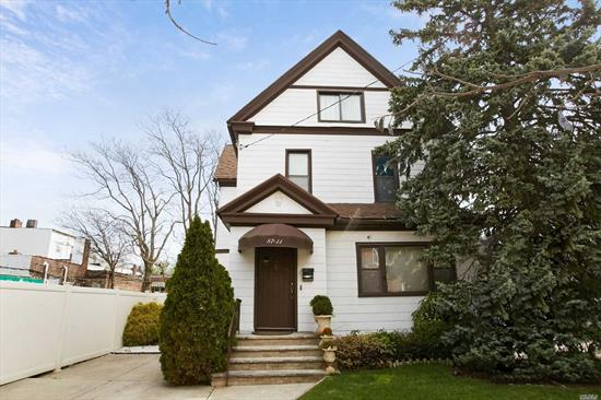 One of a kind 2 family home on extra large 58x92 lot in beautiful Richmond Hill neighborhood! House is well maintained and has two bedrooms on each floor with 3 full bathrooms and hardwood floors throughout home. Huge private driveway with two car garage and close to shops on Jamaica ave. and J/Z subway stop.