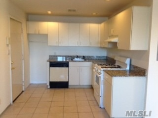 Sunlit apartment on the second floor and close to shopping and dining, beaches and parks.