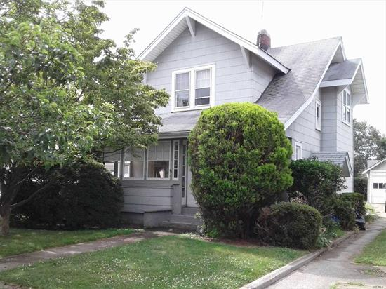 Charming Older Colonial in Need of Updating. Enclosed Front Porch, Living Room, Formal Dining Room, Sun Room, Eat-In Kitchen. 3 Bedrooms and Full Bath Up. Full Basement, Original Hardwood Floors Throughout,  Oversize Property and 2 Car Garage