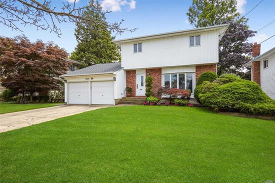 The house you want in the area you desire! Diamond Colonial boasts 4 spacious BDR, 2.5 BA, EIK, DR, LR , Den/Fam Rm, Home Theater, Finished Basement, Playroom/Lndry, CDRCL, Park-like Yard made for Entertaining w/ IGSP, Gas Heat and Appliances, CAC, Central Alarm, 200 amp, New Roof w/50 year Warranty, Anderson windows (including slider to yard) Brick Patio. All within walking distance to award winning schools, parks, shopping and LIRR. *ARC approved real estate tax reduction