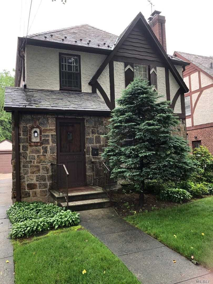First Floor - Eat In Kitchen - Living Room with Fireplace - Formal Dining Room & Enclosed Porch. Second Floor - Three Bedrooms and Full Roman Bath. Full Finished Basement with Laundry Room and Half Bath. Detached 1 Car Private Garage. Enclosed Porch. Close to Transportation.