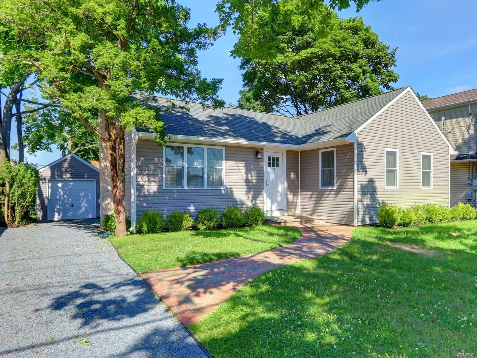 Come See This Completely Renovated 3 Bedroom 1 Bath Ranch w/unfinished basement and Detached 1 Car Garage- New Roof, Windows, Siding, Vinyl Flooring, Doors, Electric, Plumbing, Bathroom, Kitchen, Appliances, Deck, Turn Key & Ready to Move in.. West Babylon Schools - Babylon Village Amenities!!