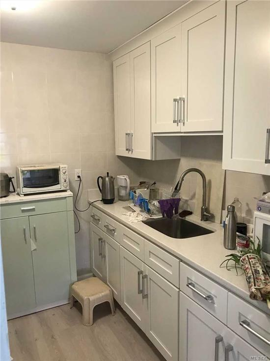 Nice 2 Bedrooms Apartment on the First Floor in the Heart of Bayside. Update Kitchen and Bath,  Large Living Room, Hardwood Floor, Drive way parking is included. Close to Bus (Q27, Q31) Excellent School District. #26 (Ps376, Ms158, Francis Lewis High School). Muse see.