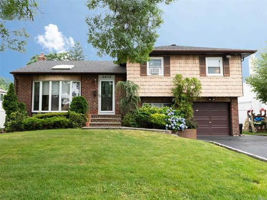 Beautiful Split in the Holiday Park Area of Wantagh. Oversized rooms with Modern updates. Open Kitchen Floor Plan with an Island and Formal Dining Room. 2 large Bedrooms and a Master Suite and closets for all your things. From the kitchen, sliders exit to the large deck and walk down to a lovely patio with fire pit. A large back yard is great for the kids to play, dogs to run. Close to schools and easy to Highways and LIRR. This is Home in Wantagh.