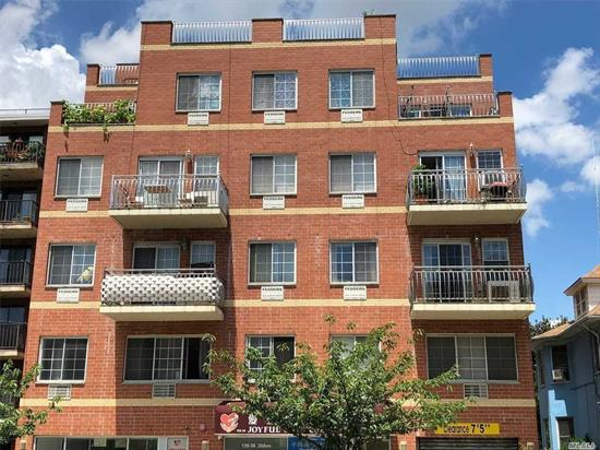 ***Elevator building, corner unit facing to south and north side***