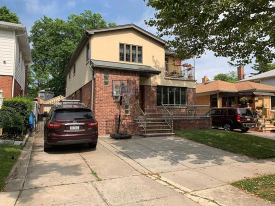 Gorgeous sunny and bright spacious 3 bedroom, 1 full bath, hard wood floors thru out .Installed Ductless Air Conditioners In Each Room, Schools district 26. Parking Spot. Great Location.Back yard , Close to Transportation LIE 495, Bus.  Near All Shopping .