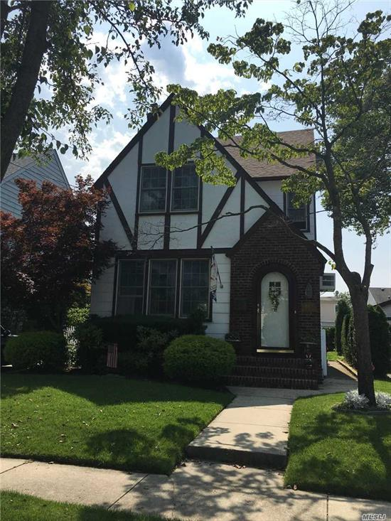 Beautiful updated and exceptionally maintained Tudor Colonial.