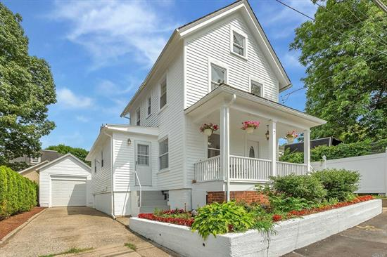 Bright & airy front porch colonial seconds from the waterfront & town. Freshly painted & updated & waiting for you! Notably high ceilings & large windows add to the openness of the space for maximum living enjoyment. The main floor boasts FLR, FDR, updated kitchen w door to front, den/4th bedrm, FB, & mud room to yard. 3 Beds & FB on 2nd Fl. Large basement w laundry & FB. Private yard & det garage w plenty of off-street parking. Wonderfully located on a dead end street and accessible to all!