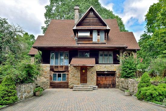 Unique Colonial with old world charm and serene setting in a cul de sac North Of 25A! The stone and woodwork in this house are second to none! Updated eat in kitchen features two Viking stoves and Wolf range. Huge entertainers deck located right off the kitchen that allows you to enjoy your spacious backyard. This home provides a Master Suite with fireplace as well as a fireplace in the Living/Dining Room combo. Recently added are Mahogony doors and new electric panel.