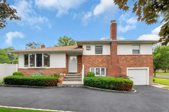 Lovely 3 bedroom 2 bath with backyard oasis on oversized property. Hardwood Floors, Renovated Eat in Kitchen , LR/DR , Den, Office, Master w bath , magnificent backyard with deck, pavers and heated In-ground, gunite pool. Convenient to LIRR, major highways and shopping. Herricks Schools.