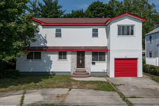 Fully Renovated Mint Colonial Featuring 6 Bedrooms, 2 Brand New Baths, EIK w/ SS Appl, Quartz Counters & Ceramic Flooring, Hardwood Floors Thru-Out, Full Finished Bsmt w/ Rec Area, Laundry. SD #2, Close to Schools/Hofstra University, Transportation, Shopping. A Must See!!