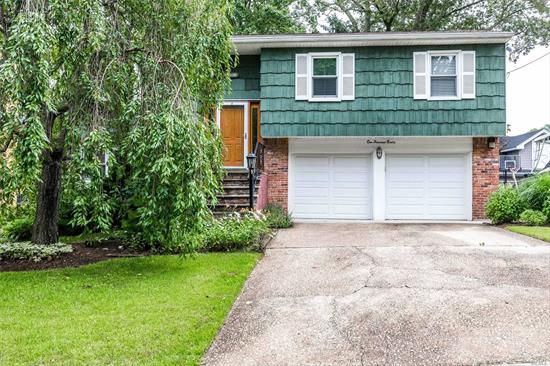 This Home is Nestled in a Fabulous Quiet But Very Convenient To All Location!! 3 Bedrooms, 2 Baths, Eat In Kitchen, Hardwood Floors, Deck... Make It Your Own!!!