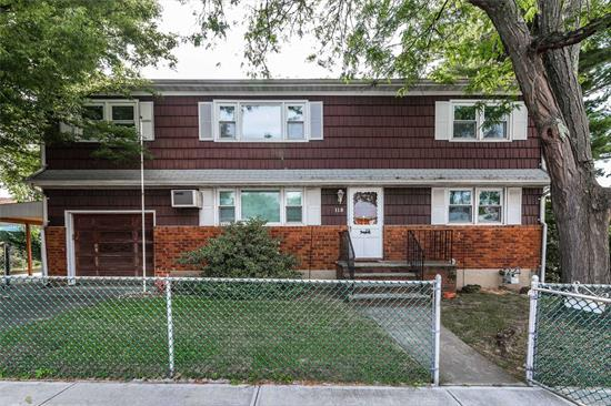 New To The Market! Expansive Colonial (1938 IntSqFt) Currently Set Up As A Mother/Daughter (W/ Proper Permits). 11 Rooms Total! This House Features 4/5 BRs (2 On The 1st Floor); 2 EIK's; 2 DRs; 2 LRs; 2 Full Bathrooms; Hardwood Floors; Full Basement~Partially Finished; OSE; Side Yards/Patio/Handicap Ramp/One Car Attached Garage. Updates Include Replacement Windows/Hot Water Heater/Gas Cooking. Kitchens & Baths Need Updating. Home Is Waiting For Your HGTV Ideas! Come Make It Your Home Sweet Home!