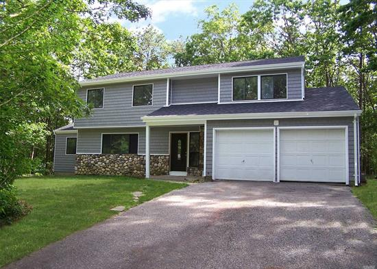 Newly Renovated Sierra Model Colonial, All on 2.18 Acres Backing to Radall Woods, Home Features 4 Bedrooms, 2.5 Baths, 2 Car Garage, Full Basement. New Roof, New Floors, New Kitchen with Stainless Steal Appliances, Q uartz Counter Tops, Yard Great for Entertainment.
