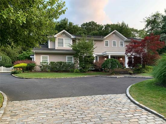 Welcome to this Beautifully Renovated Colonial in the Gates of Woodbury w/open floorplan. Completely gutted, expanded & renovated, this Mid-Block home sits on beautiful Property. It features radiant htd floors in the foyer, EIK & upstairs bthrm. The house is all gas & has a gourmet EIK w/top of the line appl, 3 Ensuites, Lots of storage, pantry, laundry & mudroom on 1st fl. Fin. Bsmt. Bkyd boasts a large stone patio w/fire pit & built-in BBQ. Syosset SD (Walt Whitman