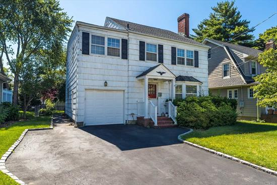 Classic Colonial with tons of potential in the Village of Rockville Centre ! This spacious 4 bedroom home offers a large Living room w/ Fireplace , Formal Dining Room , Oversized Eat In Kitchen plus a Den overlooking the private yard !! The second floor boasts generous sized bedrooms, tons of closets , large family bath and Walk up attic ! Hardwood floors throughout, attached 1 car garage, close to Shops and restaurants!