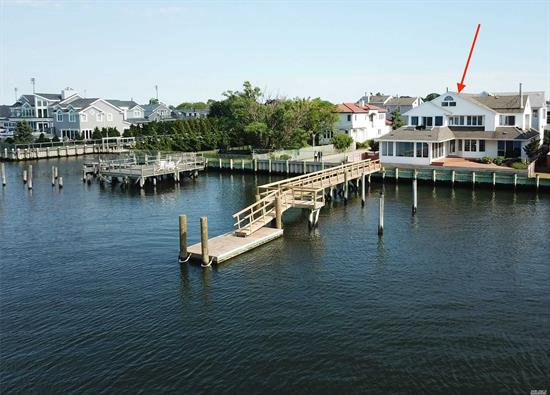 Mint Condition Newly Renovated Open Bayfront 4 Bed 3.5 Bath Home With Incredible Views Of Both Sunrise & Sunset On The Bay. New 70ft Pier with Floating Dock and Refaced Bulkhead. This 4000sf Home Has One Of The Best Waterfront Locations In Long Beach. Featuring 1 Fireplace, Hardwood Floors, And Stunning Master Bedroom. If You Are Looking For Views And Bayfront Living This Is A Must See! Assignable Flood Insurance Under $2000! Come Live On The Bay! Interior Furnishings Represent Virtual Staging.