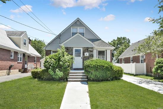 Valley Stream. Beautiful Updated House with a New Kitchen, Bathrooms, Appliances, Hardwood Floors Throughout, Separate Entrance for Basement. Must see in Person.