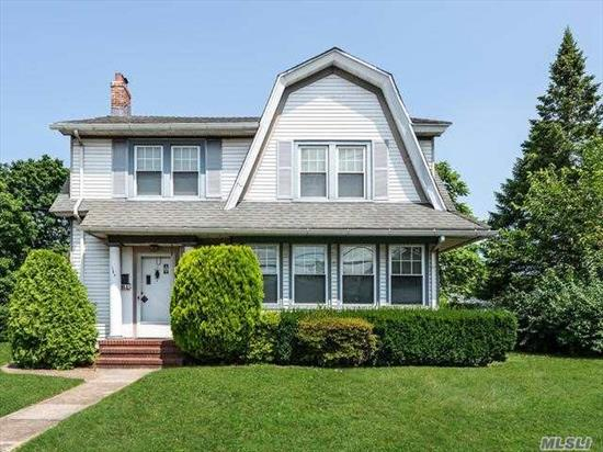 Welcome to this stately Dutch Colonial set on a rare 100x140 lot in the desired 'Boulevard Section' of Mineola. Offering over 2200 sq ft of living space plus full unfinished basement AND walk-up attic, this 4-bed/1.55 bath home is a rare opportunity w/unlimited potential. Features include huge 2-car garage, sprawling yard, updated kitchen w/granite & stainless steel appliances, potential first floor bed, stunning hardwoods throughout, prime location... Sold 'as is'