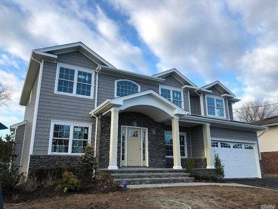 Currently Being Built! Still Time to Customize! Premier Plainview Builder! Beautiful New Construction in mid block location. Open Floor Plan. 1st Floor- EIK, FDR, FLV, Family Room W/fireplace, Bedroom with full bath, 1/2 bath, Pantry. 2nd Floor- Master w/Ensuite, 4 Additional bedrooms, 2 additional bathrooms, Laundry room. Basement- 9' Ceilings, Utilities, OSE. Photos are for Builder Workmanship, not exact model.