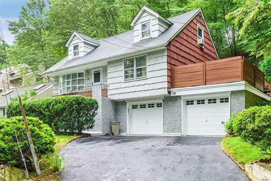 This Harborfields Cape is 4 Bedrooms/2Baths, with full basement and 2 car garages. Home is well maintained. new retaining walls, new burner. Sits on a small hill overlooking this nice neighborhood. Backyard has a covered deck, and 2 small side yards. Taxes are 10, 480. with star.