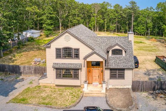 Location, Location Sits This Fabulous Vermont Inspired Nantucket-Style Home with Endless Possibilities! Open Floor Plan, Soaring Ceilings, Hardwood Floors, Custom Kitchen with Stainless Steel Appliances, Woodburning Fireplace, Master Suite with Master Bath, Walk-in Closet, and Large Balcony, New Heating System w/Propane Heat, New Cesspools, Private and Secluded 1.03/Acre Horse Property with Room for Garage! Home Needs Minor Work to be Completed, Just Needs Your Finishing Touches! Must See!
