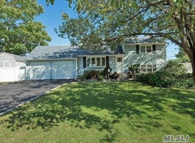 This South of Montauk BOATERS DREAM in Award Winning Islip SD Features Open Airy Floor Plan w/Updtd EIK w/Granite Counters+Under Cabinet Lighting*Newly Renovated Baths*20x20 Family Rm w/Wood Burning Stove*Home Office+Addit'l 15x20 Den! Sliding Glass Doors Leads to 30x40 PVC Deck w/Heated AGP &Tiki Bar. Other Amenities incl New Roof*Windows*Elec*Gas Burner*Hot Wtr Htr*IGS. 20x20 Attic Storage, Access to Rentable Boat Slip Up to 34' Broad Side*30 Amp Dock Elec * Flood Ins only $600 annually.