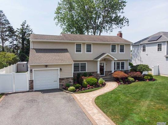 AMAZING EXPANDED COLONIAL WITH ENORMOUS BEDRMS, NEW DESIGNER BTHS, H/W FLOORS, GRANITE EIK, FORMAL DR, CAC, IGS, OPEN KITCH TO DEN, FULL FINISHED BASEMENT WITH NEW TILE FLOORS, MASTER BDRM SUITE W/ WI CLOSET, HUGE CUSTOM BTH, SPACIOUS AND SUNNY HOME, MID-BLOCK LOCATION, NEAR LIRR, GREAT SHOPPING, NEAR Y, HOME IS MOVE IN READY, 1 CAR GARAGE, NEW W/D, NEW PAVERS FRONT AND BACK PATIO, SPACIOUS YARD, BEAUTIFUL NEW FRONT STONE/VINYL FACADE WITH GREAT CURB APPEAL! HOME HAS IT ALL! FANTASTIC SCHOOLS!