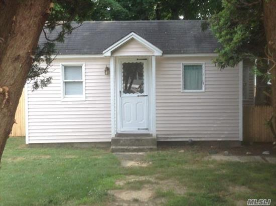 Charming & Clean Cottage Home Located In Mastic Beach.This Homes Features New Carpets & Floors, Eik, Living Room, 1 Bedroom, 1 Full Bath, Part Basement. Perfect Starter Or Retirement Home, Low Taxes. Plenty Of Room For Expansion. Walk to the beach. Why Rent When You Can Own !