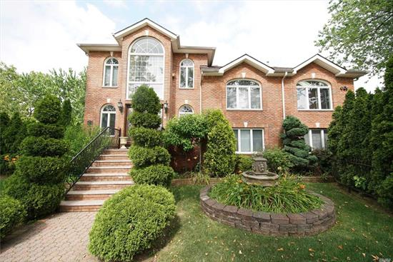 MODERN BRICK SPLIT LEVEL HOME TOTAL 5 LEVELS. 5 BEDROOM 4 BATH, COMPLETELY RENOVATED IN 2004, LOCATED AT THE MOST DESIRED AREA, ZONE FOR TOP RATED SCHOOL DIST. 26, P.S. 221 & M.S. 67, CLOSE TO HIGHWAY, FEW MINUTES TO AMERICA MALL, EXP. BUS TO CITY AND LIRR. 30 MINUTES TO MANHATTAN. IT FEATURES WITH CRYSTAL CHANDELIER, GRANTE COUNTERTOP, 2 FIRE PLACES, DARK CHERRY WOOD CARBINETS, ARCHITECTUAL ROOF SHINGLES, BUILT-IN ALARM SYSTEM, SPRINKLER SYSTEM, BACK YARD HAS NATURAL GAS GRILLING AND SWING SET
