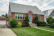 Step inside to this home that shows pride of ownership & sits on a cul de sac!! The updated amenities are truly for today's buyer to enjoy their new home. The amenities include gleaming hardwood flrs/crown molding/anderson windows/eat in kitchen w/ door to yard/ oak cabinets/ ceramic tile/ updated baths/ bedrooms upstairs are dormered Master has 2 closets/2nd bedroom upstairs has a walk in closet/200 AMP/trek deck & patio/fenced yard/peerless boiler & upd hw heater.