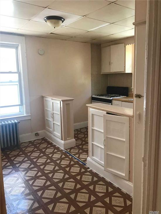 Spacious One Bedroom for Rent in Richmond Hill. Features Living Room, Dining Room-Kitchen Combo, and 1 Full Bath. Heat and Water Included. Tile Flooring. Convenient to Public Transportation and Shops.