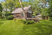 EAST QUOGUE INCREDIBLE VALUE!!! Attention first time Homebuyers/Builders/Investors!!! Unique one of a kind opportunity with this 3 bedroom, 2 bath home, ideally nestled on a shy half acre lot located just minutes to the Ocean, Bay beaches and shopping! Come enjoy/enhance/expand, add a pool and enjoy easy Hamptons style living all summer long! Not to be missed! Will not last!