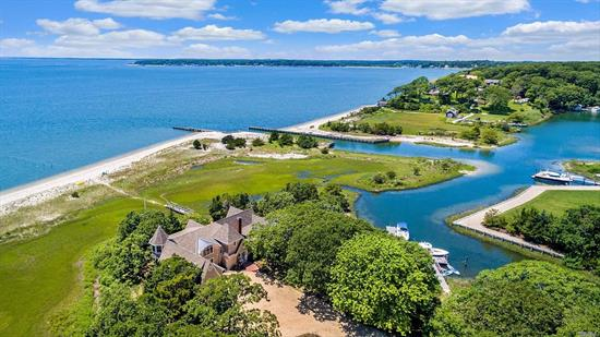 Over the wooden bridge, ensconced in the natural environment of the Great Peconic Bay, a sandy beach, and lush wetlands, Bridges to Bliss blends seamlessly into the landscape. Bridges to Bliss is private, surrounded by 245' of beachfront, 1085' of waterfront on Wunneweta Pond, with a protected deep water dock & quick access to the bay, plus room for pool. Newly renovated 6-bed, 5-bath Nantucket style beach house w/ beautiful southwest sunsets from every room. For the most discerning buyer.