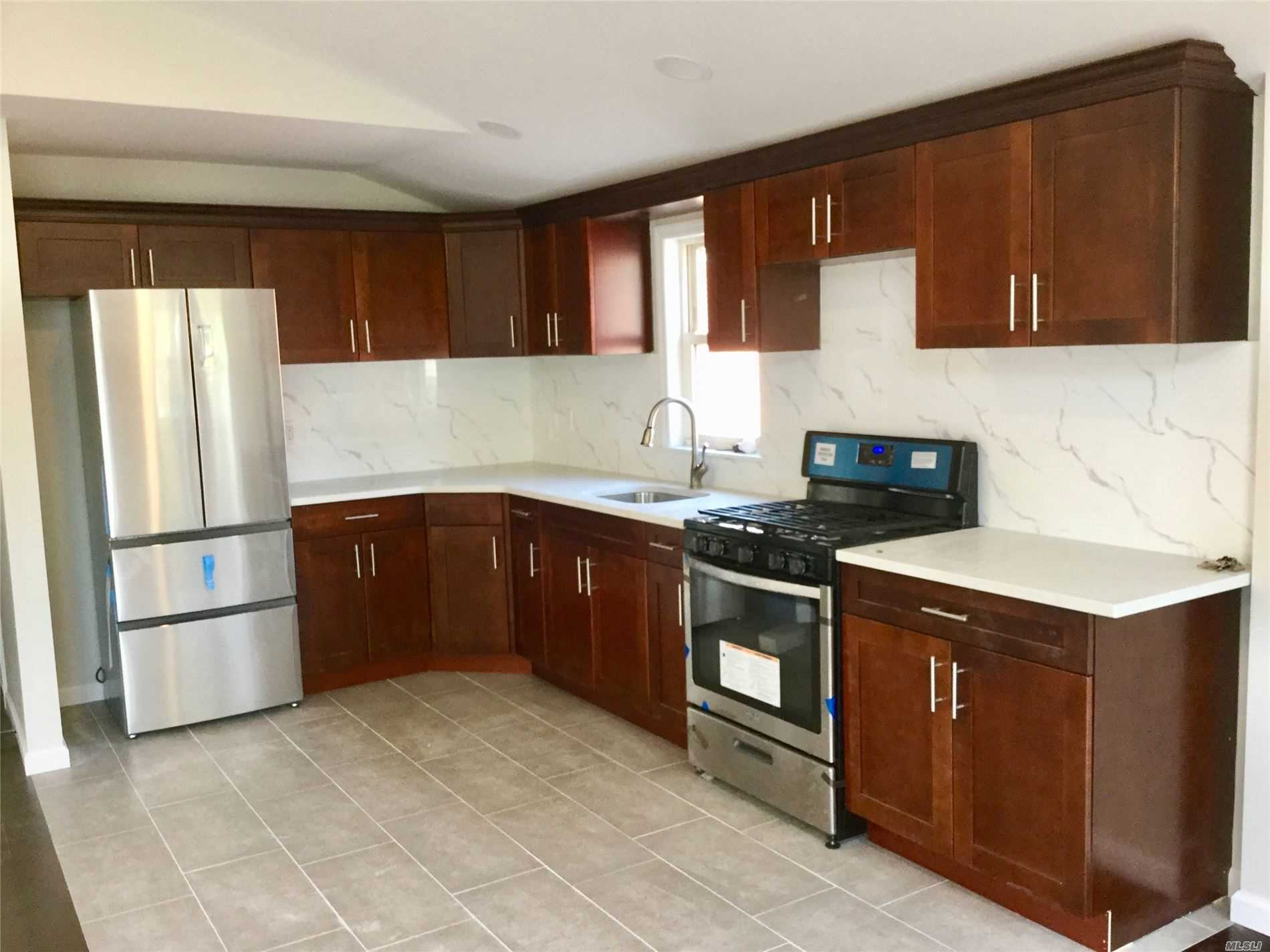 NEWLY RENOVATED 1ST FLOOR DUPLEX WITH BASEMENT, TOTAL 2200 SQ FT. 3 BR 2.5 BA, LR/DR, FULL FINISHED BASEMENT WITH INSIDE & OUTSIDE ACCESS. TENANT PAYS ALL UTILITIES EXCEPT WATER. DRIVEWAY AVAILABLE AT EXTRA $$$. ZONED FOR PS 162, JHS74, FRANCIS LEWIS H.S. CLOSE TO KISSENA CORRIDOR PARK & I-495 EXPRESSWAY.