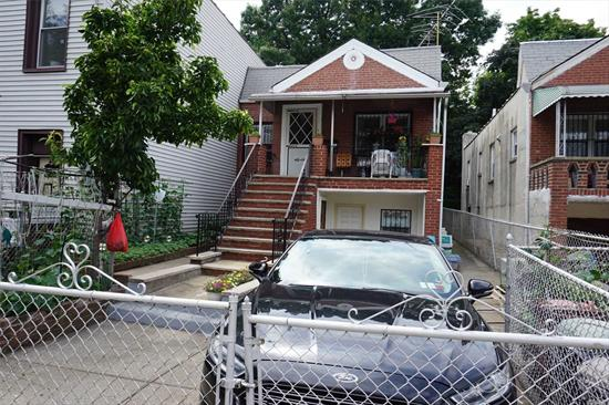 Great opportunity: Legal 2-Family solid brick, Mother/Daughter. Private driveway and 1-car garage. Lovely private backyard. Close proximity to #7 subway - 15 minutes to Manhattan. Convenient to shopping, restaurants, etc.