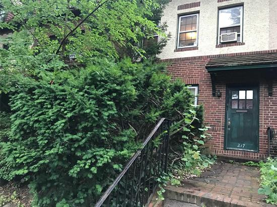 Ideally located on a charming tree lined street, this classic Tudor 3 Bedroom/1.5 Bath Townhouse is situated in iconic Forest Hills Gardens. Zoned for PS 101 & steps from Austin Street, E/F/LIRR. This classic Tudor offers features: fireplace, formal dining room, deck and off street parking. Here's your chance! Bring your pets!