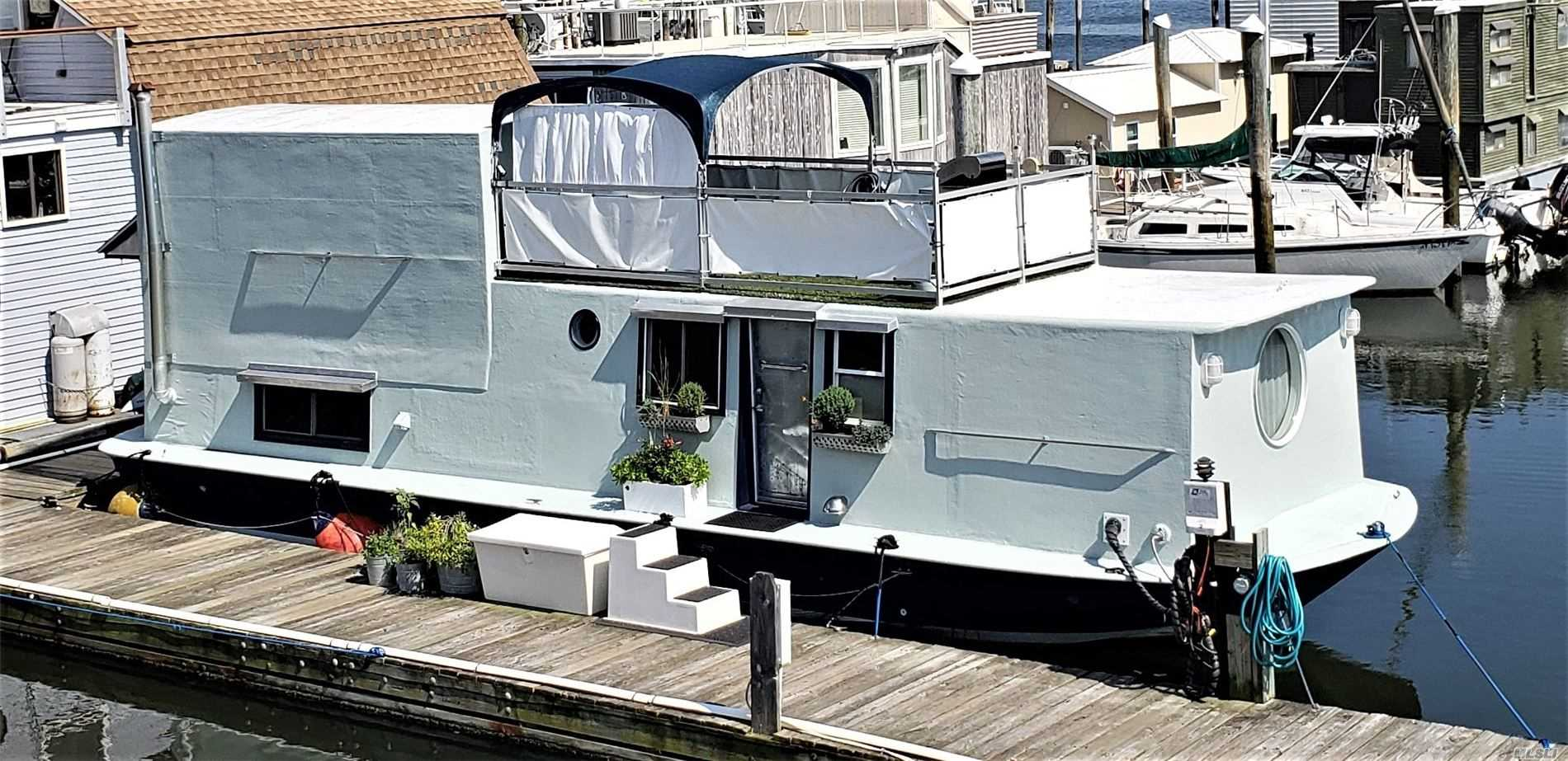 48' X 14' Chris Craft hull Houseboat built on a sturdy V-Hull. House was built with traditional framing, insulation, sheeting and wrapped in fiberglass. It features (approx. 600 sqft) one bedroom, living room, lovely kitchen, full bath and office area. It has washer/dryer, portable A/C unit, plenty of storage space and was recently painted. An amazing upper deck makes it absolutely a fun place to live on the waterfront!! Sold 'as is'. Slip fee $700/month. Cash transaction only.