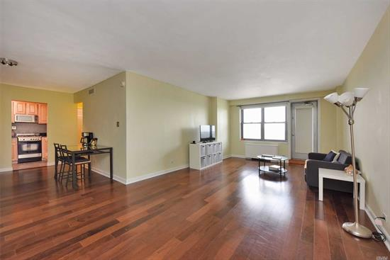 SPACIOUS, OPEN, AND A BALCONY! L-shaped Floor Plan Separates Dining and Living Area. Excellent Move-in Condition, On High Floor. The Building Offers 24hr Doorman, Gym, Sundeck, Central AC And Heating, And Indoor/Outdoor Parking. Just 2 Blocks From E and F Express Subway, LIRR. Steps To Express Manhattan Buses. Easy Access To Shopping, Forest Park, Major Highways And Airports.