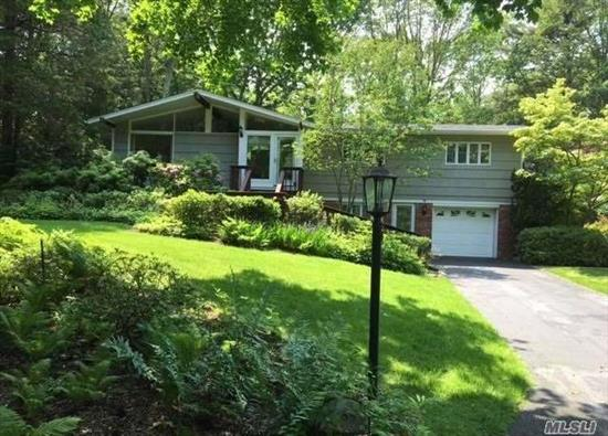 Classic Hansen Contemporary on Private 1.06 acre. Total Privacy Close to Northport Village. Open Floor Plan with Large Windows, Vaulted Ceilings, Hardwood Floors, Central Air Conditioning