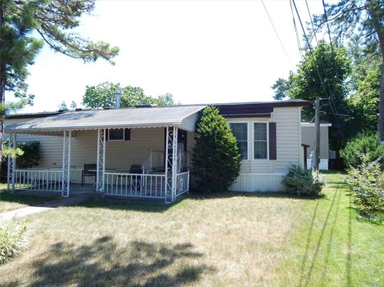 55+ Community. Beautiful home in meticulous condition on lovely corner lot with mature plantings and arborvitae. Large covered patio and private driveway. New windows and side door put in in 2017. Central Air and heating system works great. Clean as a whistle. Come see what may be your new home. Monthly Fee is $725 which includes lot rent, water, cesspool, trash/snow removal, clubhouse. Tax information to be added 7/15/19.