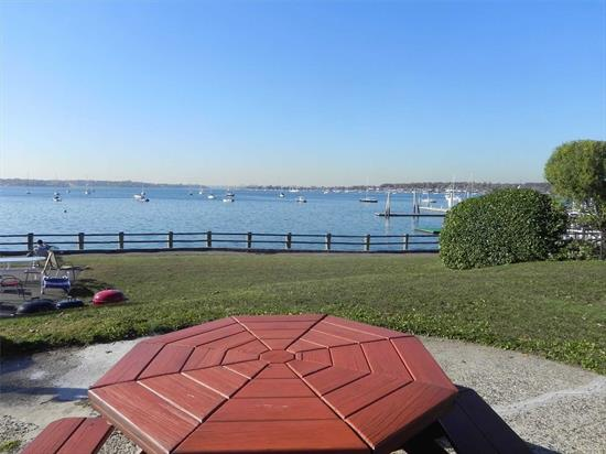 Port Washington. Rare! 1st Floor 2 Bedroom 1 Bath W/Huge Private Deck In Pet Friendly Waterfront Garden Apartment Complex. Kitchen With Separate Dining Area, Polished Hardwood Floors Throughout, Both Bedrooms Generously Sized. Resident Super, On-Site Laundry Rooms, Dedicated Parking May Be Available (Additional $). Can Bbq On Magnificent Grounds Overlooking Water, Use Of Private Dock.